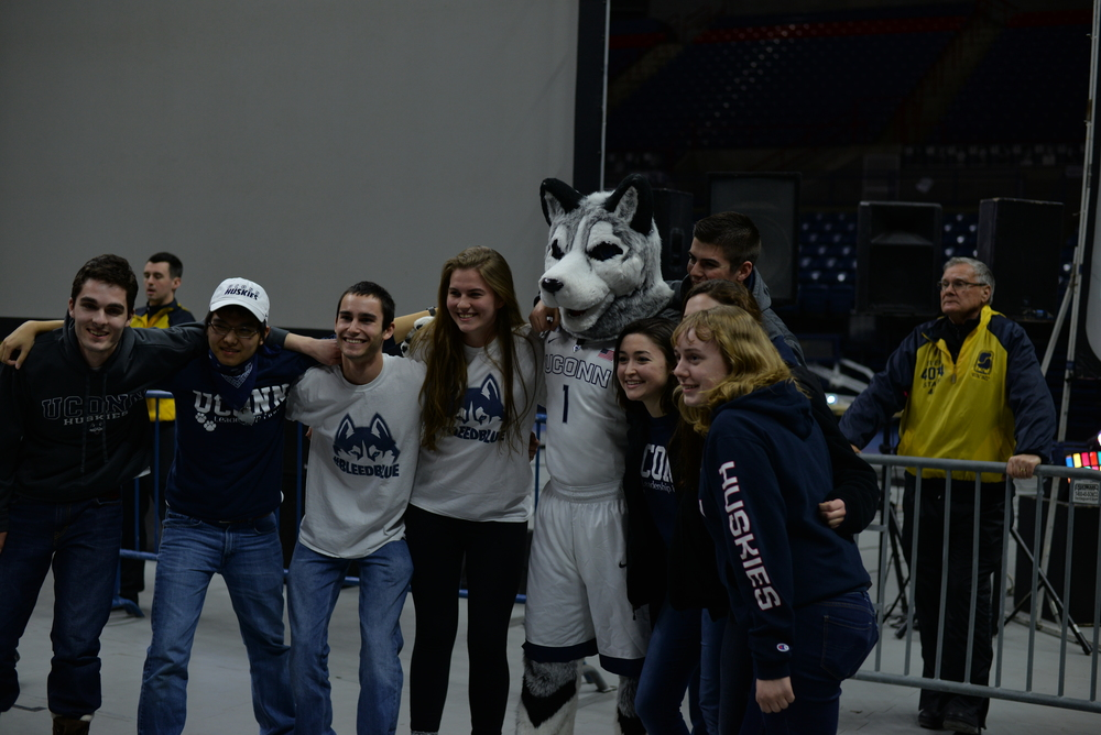 Students and fans take their picture in Gampel Pavillion during the NCAA women's championship game between UConn and Syracuse. The game was played at the Bankers Life Fieldhouse in Indianapolis, Ind., on Tuesday, April 5, 2016. (Amar Batra/Daily Campus)