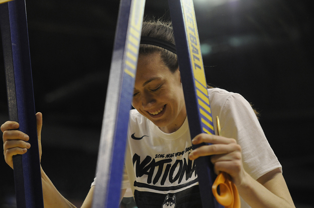 Breanna Stewart climbs the ladder to cut down the nets following UConn's 82-51 victory over Syracuse in the national championship game at Bankers Life Fieldhouse in Indianapolis, Ind. on Tuesday April 5, 2016. Stewart has been named the Most Outstanding Player of the Final Four four times, a collegiate record. (Bailey Wright/The Daily Campus)