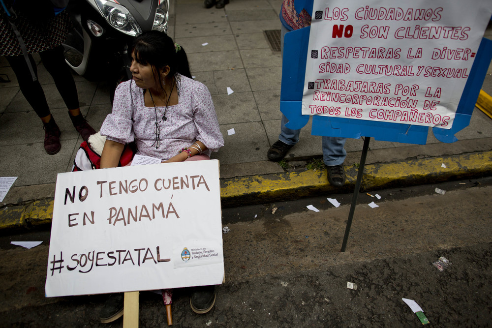 "A worker demonstrates outside the Labor Ministry with a sign that reads in Spanish ""I don't have an account inPanama,"" in Buenos Aires, Argentina, Wednesday, April 6, 2016. Her sign is a jab at Argentina's President Mauricio Macri, whose family name was included in documents leaked from a panama law firm, coined the ""panama papers,"" that lists his family in connection with a Bahamas-based offshore company. Ministry workers are on strike to demand the immediate reinstatement of dismissed workers. (AP Photo/Natacha Pisarenko)"
