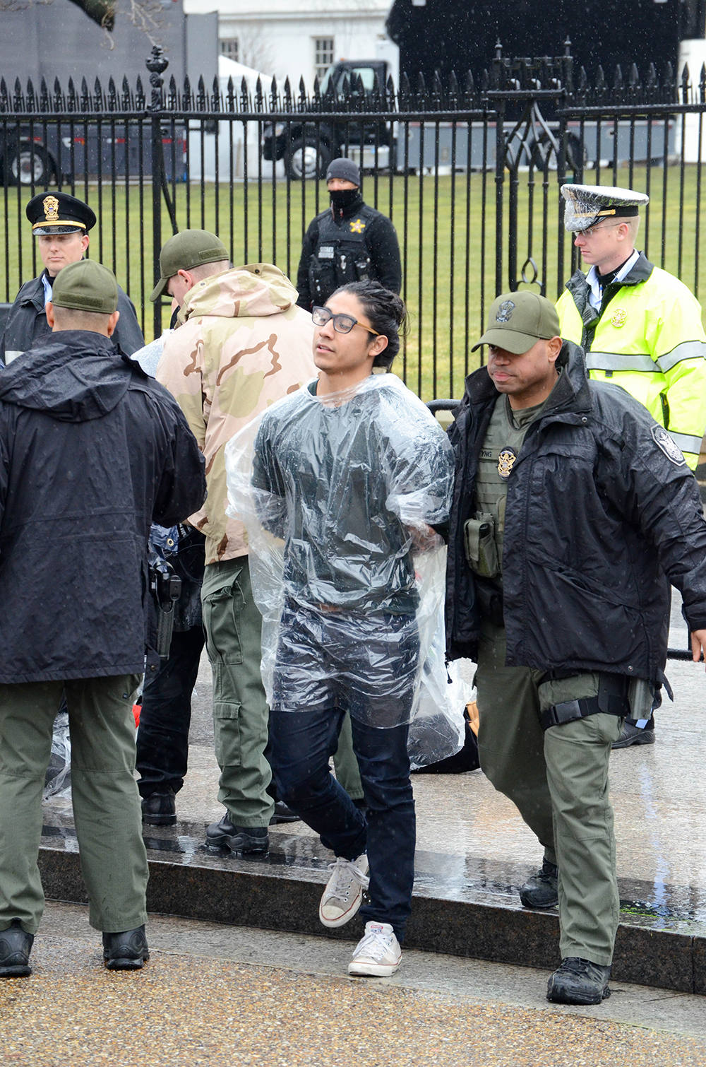 UConn student Eric Cruz López is walked toward a van after being handcuffed by United States Park Police during a civil disobedience action in front of the White House in February 2016. (Courtesy/Eric Cruz López)