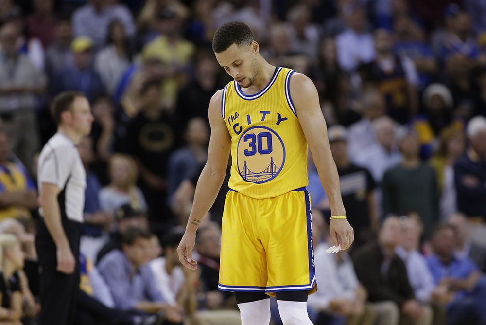 Golden State Warriors'Stephen Curry (30) looks down in the closing minutes of a 124-117 overtime loss to the Minnesota Timberwolves during an NBA basketball game Tuesday, April 5, 2016, in Oakland, Calif. (AP Photo/Marcio Jose Sanchez)