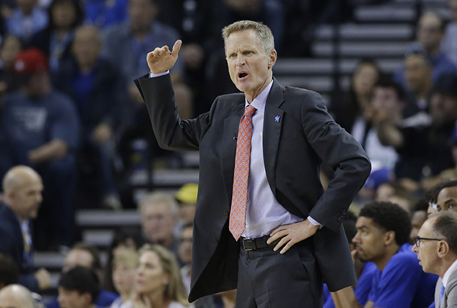 Golden State Warriors head coach  Steve   Kerr  yells out instructions during the first half of an NBA basketball game against the Boston Celtics Friday, April 1, 2016, in Oakland, Calif. (AP Photo/Marcio Jose Sanchez)