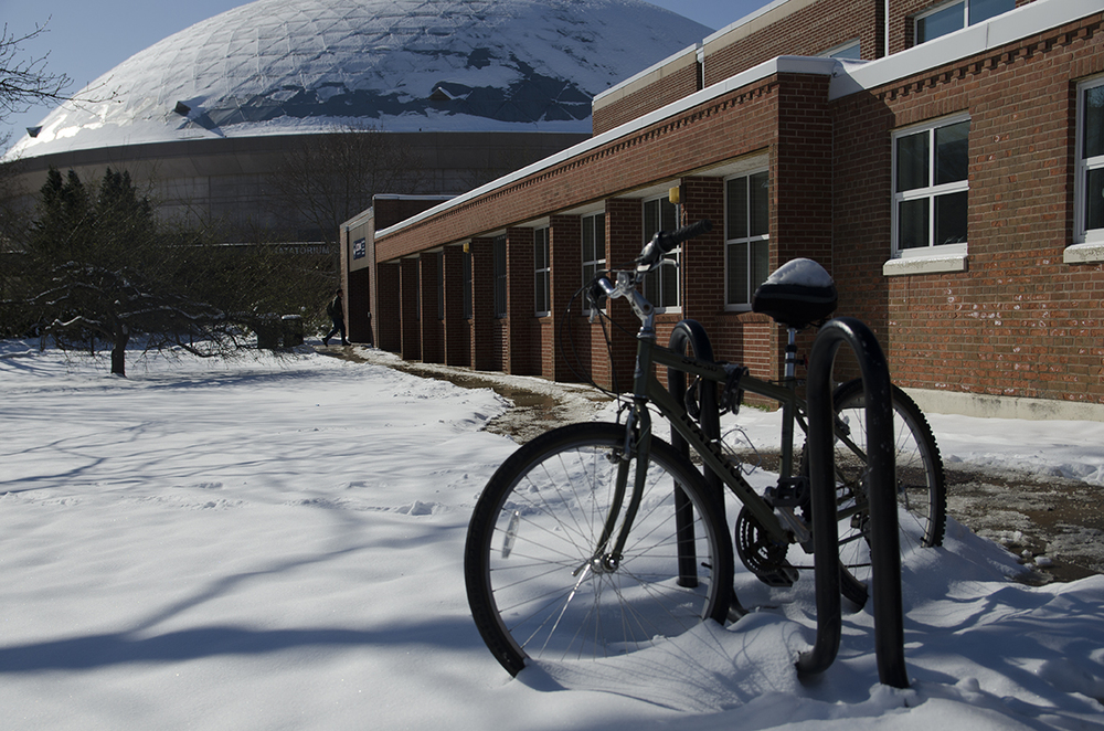 A student's bike is parked at a bike stand outside the Student Recreation Facility. The Student Recreation Facility recently announced it will open a Cycle Share program for students to rent bikes for the day. (Rebecca Newman/Daily Campus)