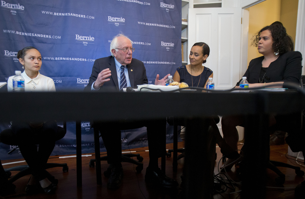 "In this Dec. 7, 2015, file photo, Sanders discusses his ""Family First"" immigration plan, during a live broadcast from his campaign office in Washington. Joining Sanders are from left to right, Santos Guevara Amaya, who immigrated from El Salvador; Erika Andiola, Latino Outreach Strategist for Bernie Sanders 2016; and Catalina Velasquez, president and founder of Consult Catalina and member of the transgender community. (AP Photo/Pablo Martinez Monsivais, File)"