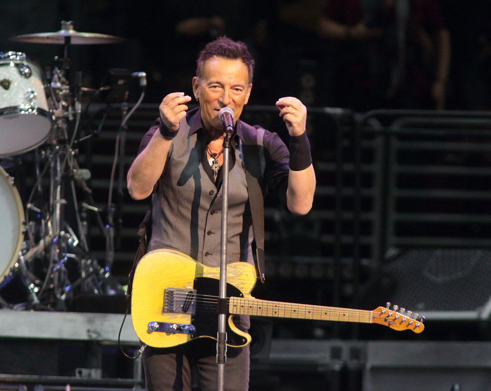"In this Feb. 12, 2016 file photo, Bruce Springsteen performs in concert with the E Street Band during their ""The River Tour 2016"" at the Wells Fargo Center in Philadelphia. Springsteen has canceled his concert in North Carolina, citing the state's new law blocking anti-discrimination rules covering the LGBT community. In a statement on his website Friday, April 8, 2016, Springsteen said he was canceling the concert scheduled for Sunday in Greensboro because of the law, which critics say discriminates against gay, lesbian, bisexual and transgender people. (Photo by Owen Sweeney/Invision/AP, File)"