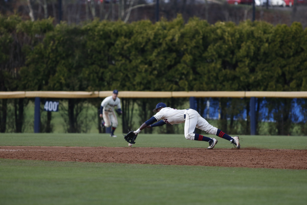 UConn junior infielder Aaron Hill makes a stop during the Huskies' game against Tulane at J.O. Christian Field in Storrs, Connecticut on Saturday, April 2, 2016. (Tyler Benton/The Daily Campus)