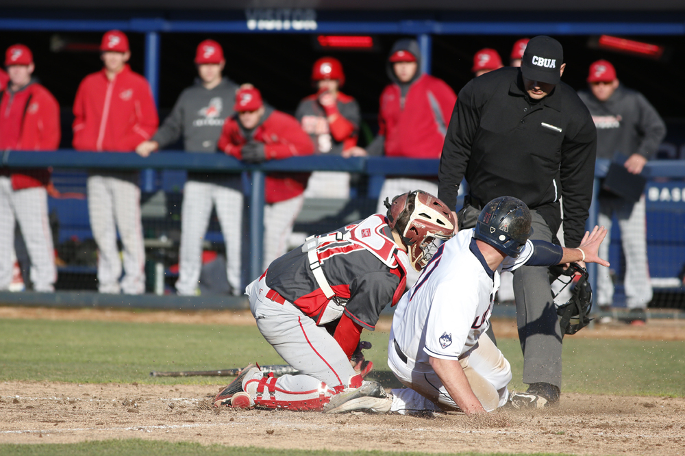 First baseman Bobby Melley slides into home during UConn's 2-1 victory over Fairfield at J.O. Christian Field on Tuesday April 12, 2016. Melley was called out on the play. (Tyler Benton/The Daily Campus)
