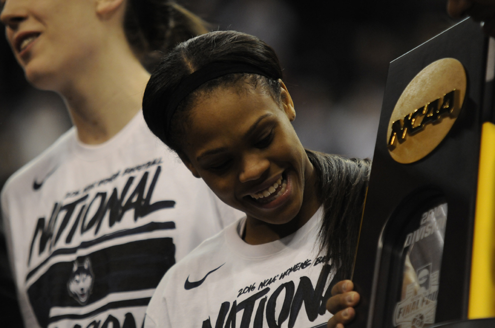 Moriah Jefferson celebrates after winning her fourth national championship at the Banker's Life Fieldhouse. UConn has won 11 national championships under Geno Auriemma. (Bailey Wright/The Daily Campus)