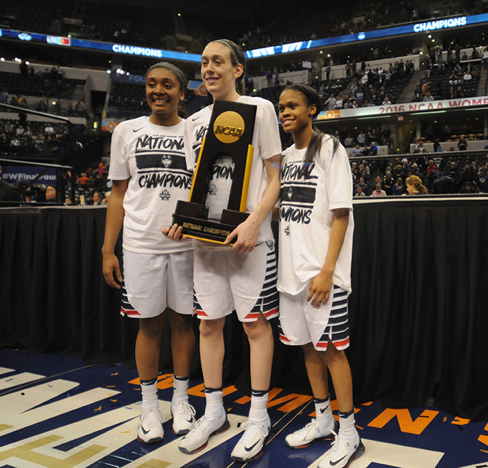 Morgan Tuck, Breanna Stewart and Moriah Jefferson celebrate winning the national championship over Syracuse at the Bankers Life Fieldhouse on Tuesday April 5, 2016. Stewart, Jefferson and Tuck were the first three players selected in the WNBA Draft. (Bailey Wright/The Daily Campus)