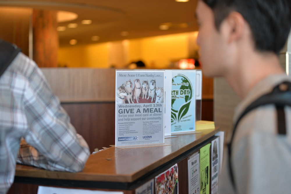 Give A Meal, an event by Dining Services that raises money by flex pass donations, is advertised in McMahon Dining Hall. (Amar Batra/Daily Campus)
