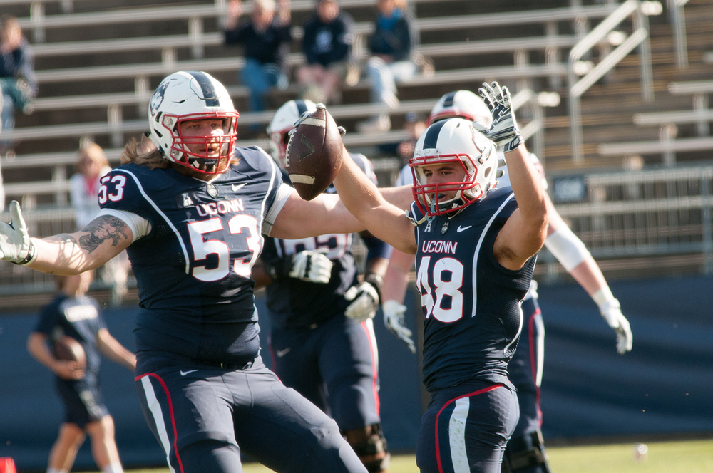 Andreas Knappe (#53) and Jason Thompson (#48) celebrate during spring football at Pratt & Whitney Stadium at Rentschler Field on Saturday April 16, 2016. (Jackson Haigis/The Daily Campus)