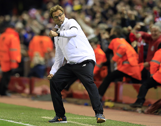 Liverpool's head coach Juergen Klopp celebrates after his team scored during the Europa League quarterfinal second leg soccer match between Liverpool FC and Borussia Dortmund in Liverpool, England, Thursday, April 14, 2016 . (AP Photo/Jon Super)
