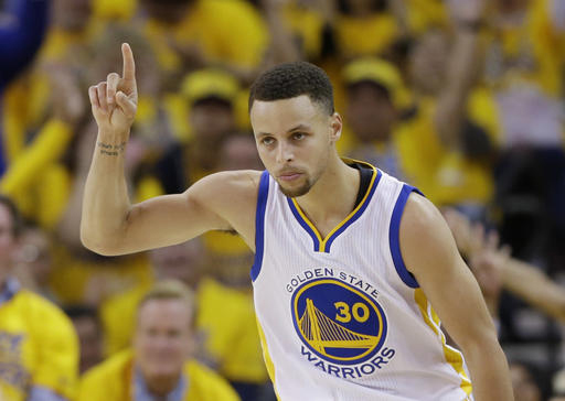 Golden State Warriors' Stephen Curry celebrates after scoring against the Houston Rockets during the first half in Game 1 of a first-round NBA basketball playoff series Saturday, April 16, 2016, in Oakland, Calif. (AP Photo/Marcio Jose Sanchez)