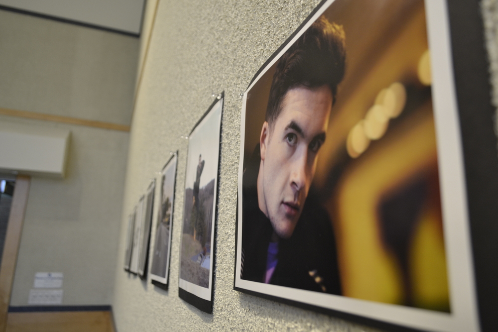 "Pictures line the walls during the University of Connecticut's SHAPE 'As I Am' art show. The gallery was covered with photographs of students from every race, sex and walk of life at UConn. The pictures featured car enthusiasts, ROTC cadets, strength athletes, ""Starcraft"" gamers and dining hall employees. (Olivia Stenger/The Daily Campus)"