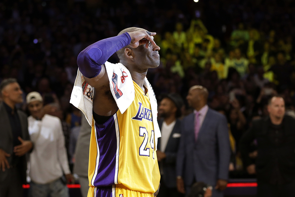 Los Angeles Lakers' Kobe Bryant solutes as he acknowledges fans after the last NBA basketball game of his career, against the Utah Jazz on Wednesday, April 13, 2016, in Los Angeles. Bryant scored 60 points as the Lakers won 101-96. (AP Photo/Jae C. Hong)