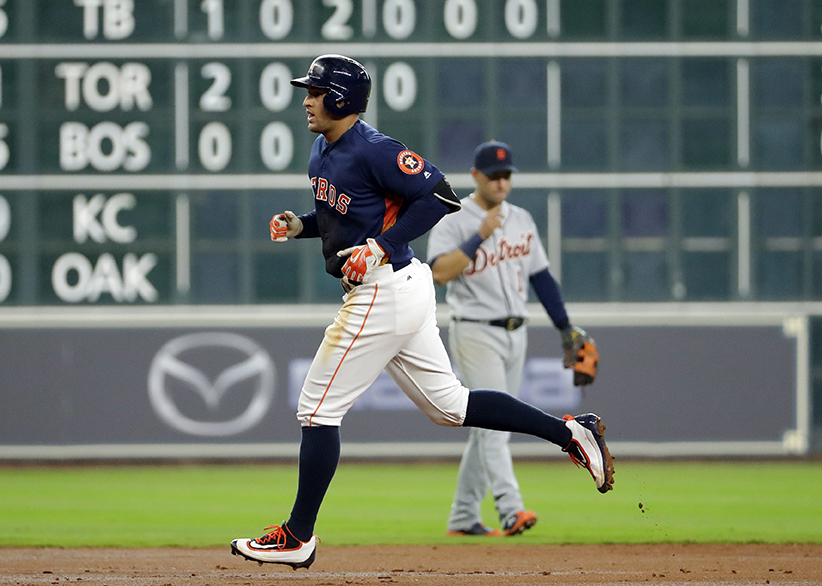 Houston Astros' George Springer runs the bases after hitting a home run against the Detroit Tigers during the third inning of a baseball game Sunday, April 17, 2016, in Houston. (AP Photo/David J. Phillip)