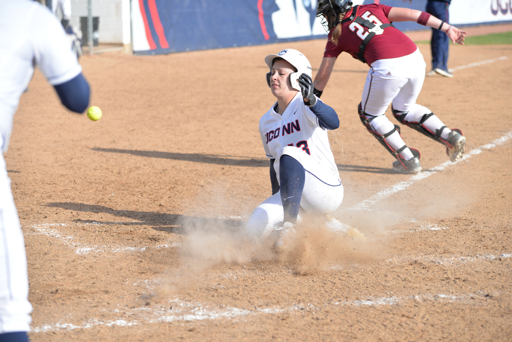Alyson Ambler slides into home at the Burrill Family Field. The UConn women's softball team fell to the UMass Minutemen 7 to 4 at Burell Family Field on Tuesday afternoon. (Amar Batra/The Daily Campus)