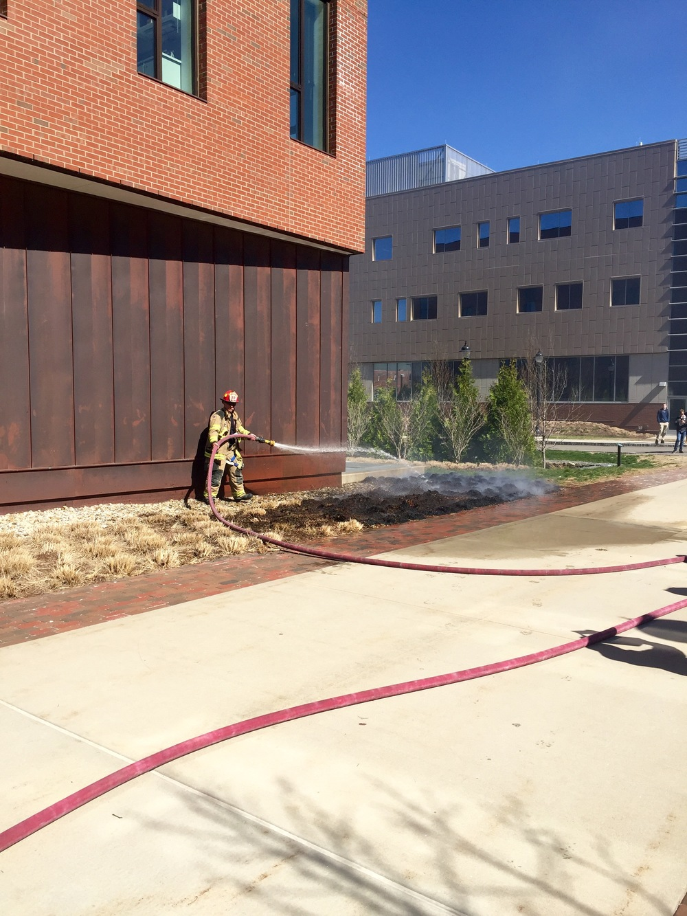 A brush fire outside of Oak Hall was put out by UConn firefighters around 3:15 p.m. on Wednesday, April 20, 2016. (Cheyenne Haslett/Daily Campus)