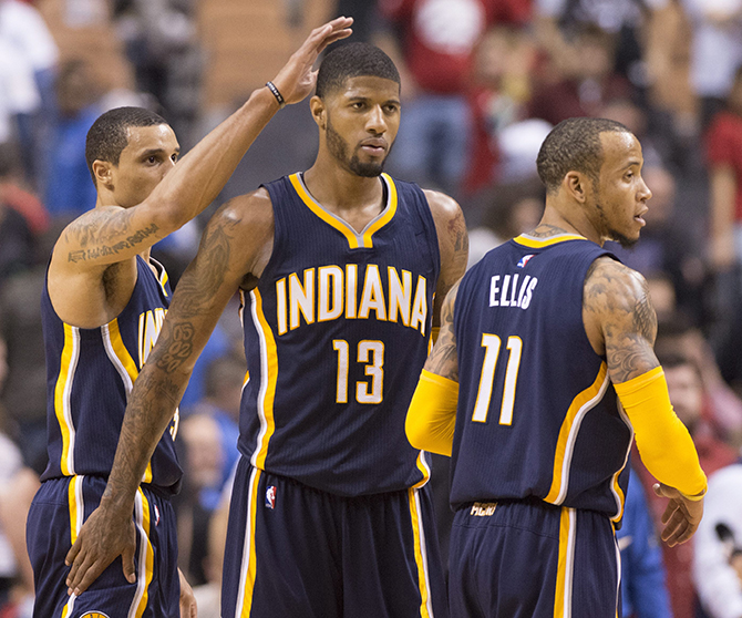 Indiana Pacers' Paul George (13), Monta Ellis (11) and George Hill (3) celebrate after defeating the Toronto Raptors 100-90 in Game 1 in the first round of the NBA basketball playoffs in Toronto, Saturday, April 16, 2016. (Frank Gunn/The Canadian Press via AP) ]