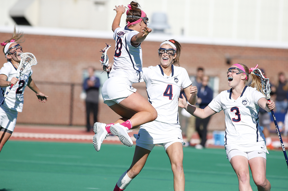 Grace Nolan (#10) leaps in the air to celebrate with her teammates after scoring a go-ahead goal in the final seconds of UConn's 9-8 victory over Georgetown at the Sherman Family Sports Complex on Wednesday April 20, 2016. (Tyler Benton/The Daily Campus)