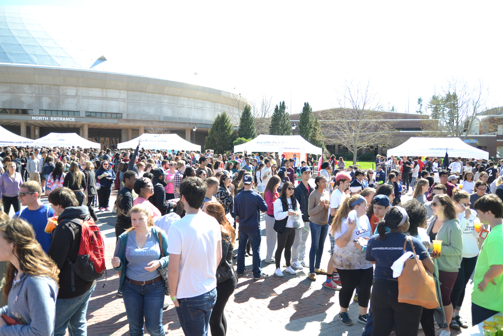 Students rock out to local bands while eating food provided by D.P. Dough, Moes, and Haru Aki Cafe at Local Beats and Local Eats on April 25, 2015 during last year's Spring Weekend. (Amar Batra/Daily Campus)