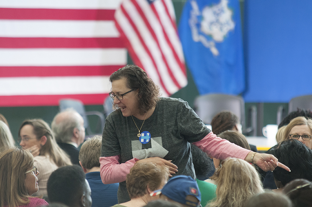 A Hillary Clinton supporter talks to others in the crowd before Clinton's forum on gun violence at the Wilson-Gray YMCA in Hartford on Thursday, April 21, 2016. (Kyle Constable/Daily Campus)