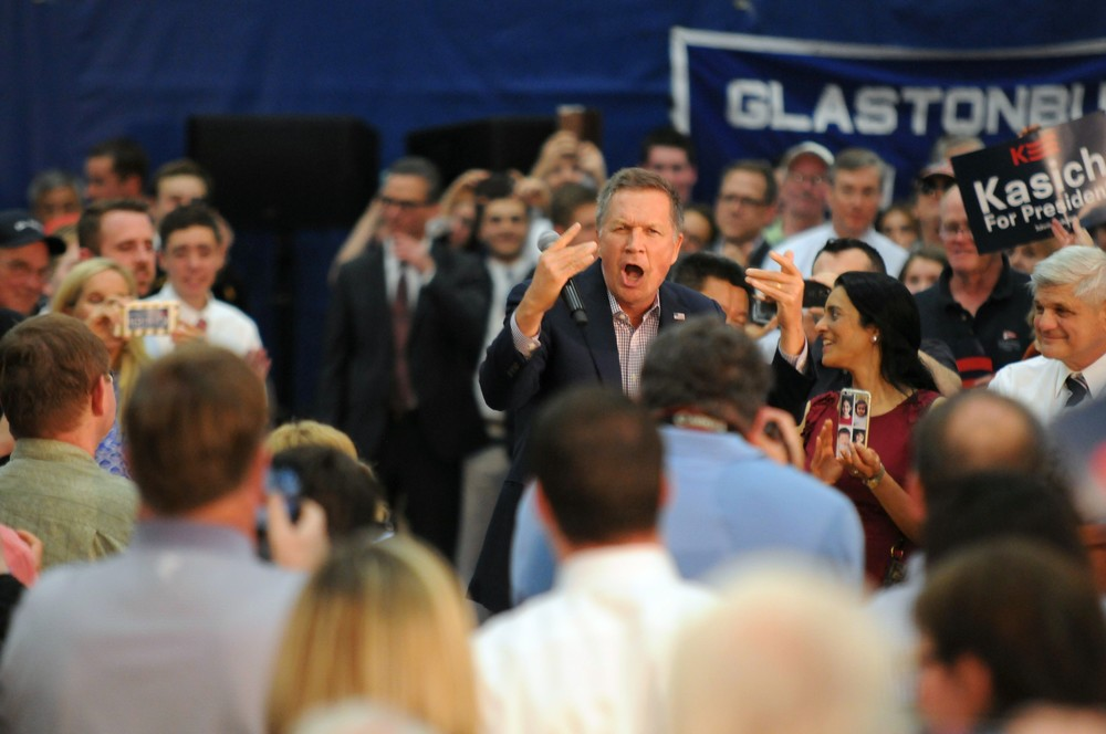 "Republican presidential candidate John Kasich danced onto the stage as Walk The Moon's ""Shut Up and Dance"" played through the sound system during a town hall at Glastonbury High School on Friday, April 22, 2016.   (Kyle Constable/The Daily Campus)"