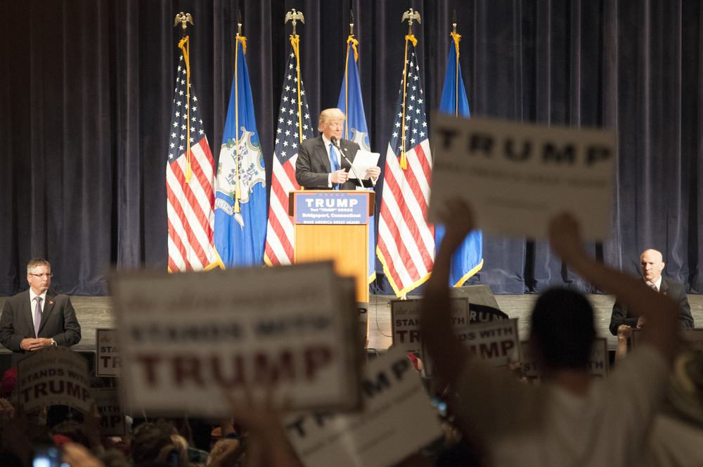 Republican presidential candidate Donald Trump reads from his notes about Connecticut's economy during a rally at Klein Municipal Auditorium in Bridgeport on Saturday, April 23, 2016.