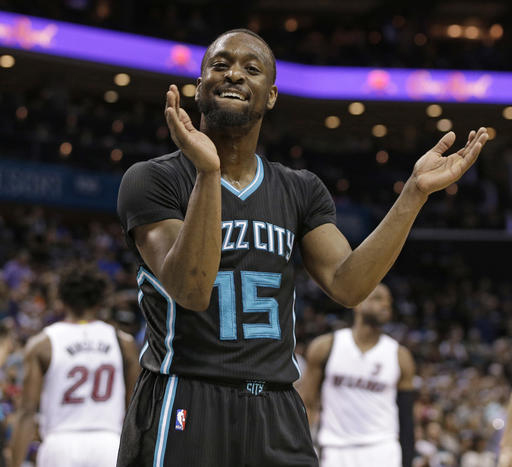 Charlotte Hornets' Kemba Walker (15) celebrates after making a basket against the Miami Heat during the second half in Game 3 of an NBA basketball playoffs first-round series in Charlotte, N.C., Saturday, April 23, 2016. The Hornets won 96-80. (AP Photo/Chuck Burton)