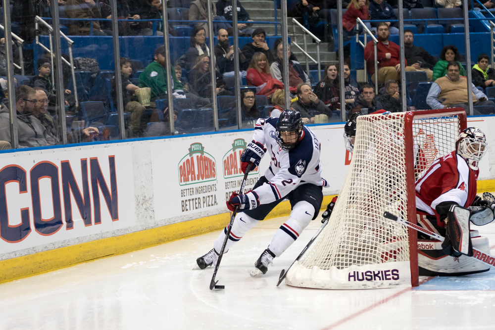 Freshman forward Max Letunov skates behind the net during a game against Northeastern on Friday, Feb. 19 at the XL Center in Hartford. Letunov led the team with 40 points, 24 assists and 16 goals. He was a big factor in the Huskies' 11-21-4 season that saw them host a Hockey East playoff tournament. (Tyler Benton/The Daily Campus)