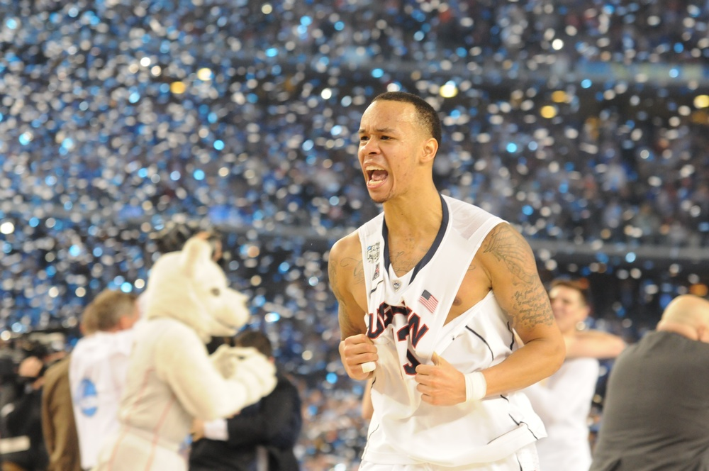 Shabazz Napier grabs his jersey in celebration after winning the 2014 NCAA men's basketball National Championship game, 60-54, against the University of Kentucky on April 7, 2014 at AT&T Stadium in Arlington, Texas. He was the tournament MVP and helped lead the Huskies on a storied title run. (File photo/The Daily Campus)