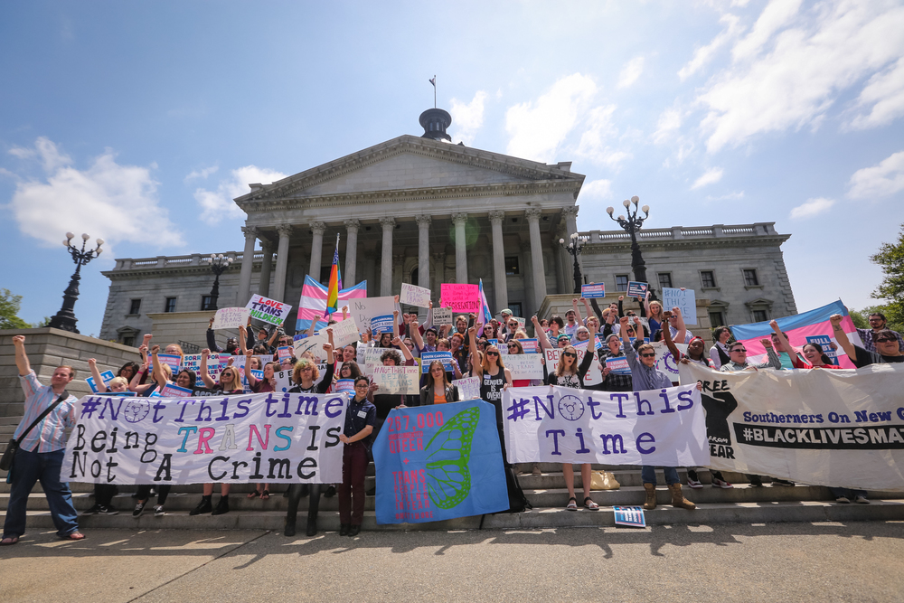 The Trans Student Alliance at the University of South Carolina holds a rally and news conference at the state Capitol to protest a controversial bill that would ban transgender people from choosing the bathroom they use Wednesday, April 13, 2016, in Columbia, S.C. (Tim Dominick/The State via AP)