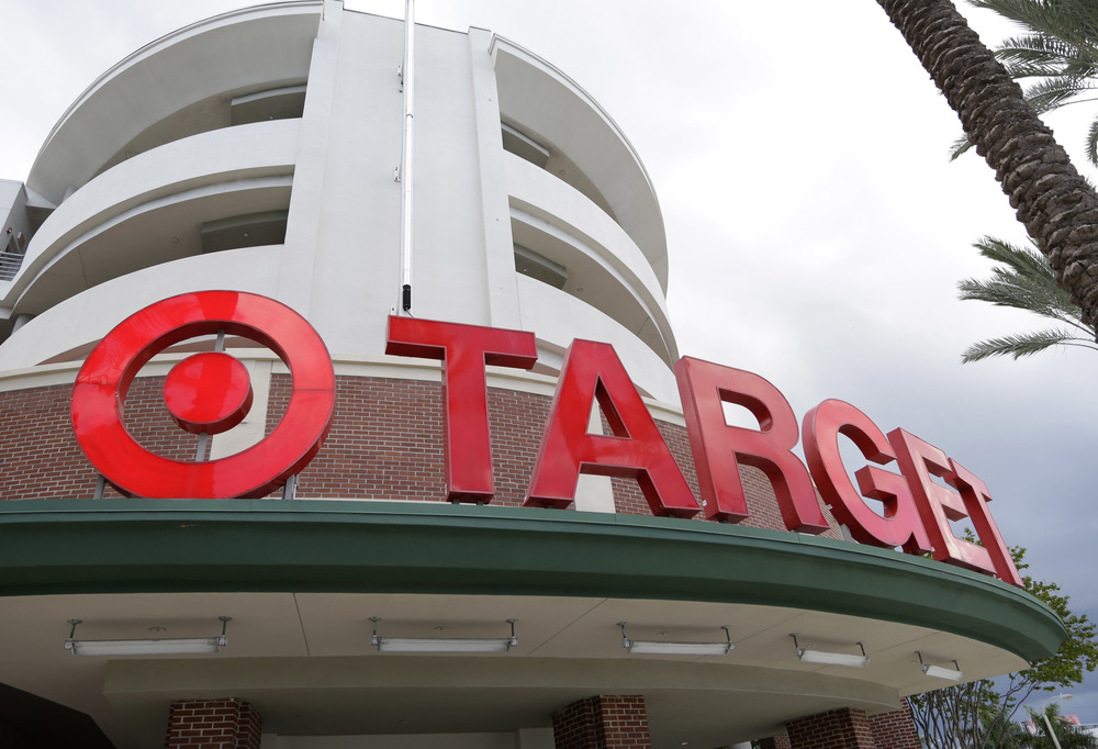 "This Monday, Aug. 11, 2015, file photo, shows a Target store in Miami. Target is making a stand on the debate around what type of bathrooms transgender people can use. In a statement posted on its company website Tuesday, April 19, 2016, the discounter, based in Minneapolis, said transgender employees and customers can use the restroom or fitting room facility that ""corresponds with their gender identity."" (AP Photo/Lynne Sladky, File)"