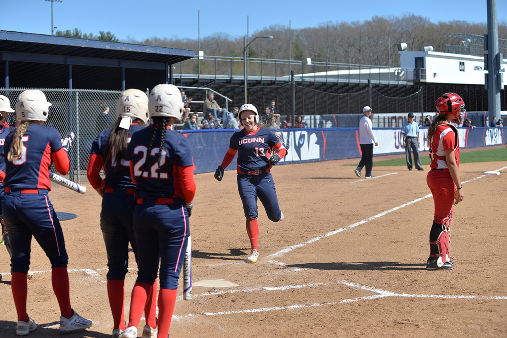 Alyson Ambler, #13, is greeted by teammates after scoring a run during UConn's 16-0 win over Hartford on Wednesday April 27, 2016 at the Burrill Family Field. (Amar Batra/The Daily Campus)