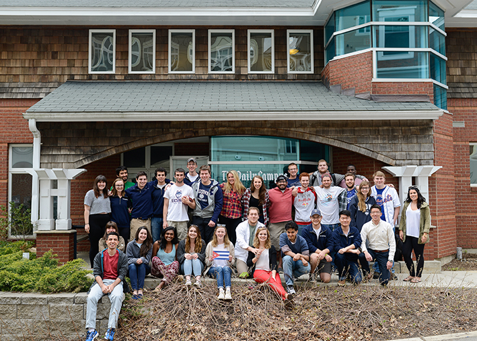 Much of the 2015-2016 Daily Campus staff gathers outside the Daily Campus building for a group photo. (Jason Jiang/Daily Campus)