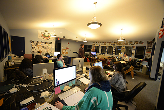 Employees of The Daily Campus work to design the next-day's paper. Students, including layout designers, copyeditors, editors, writers, digital producers and, of course, the editor-in-chief, come in every night to work on the daily newspaper. (Amar Batra/Daily Campus)