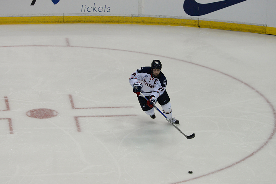 Senior captain Patrick Kirtland skates with the puck during a home game for UConn. Kirtland finished the season with 17 points. (Amar Batra/The Daily Campus)