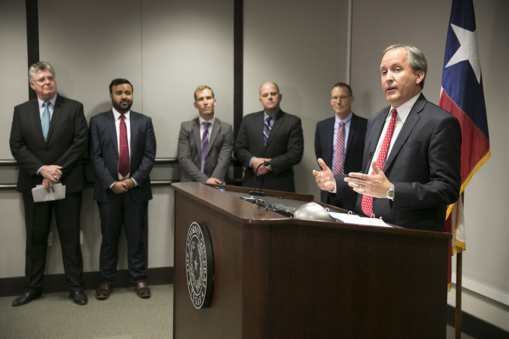 Republican Texas Attorney General Ken Paxton, right, announces Texas' lawsuit to challenge President Obama'stransgender bathroom order during a news conference in Austin, Texas, Wednesday May 25, 2016. Texas and several other states are suing the Obama administration over its directive to U.S. public schools to let transgenderstudents use the bathrooms and locker rooms that match their gender identity. (Jay Janner/Austin American-Statesman via AP)