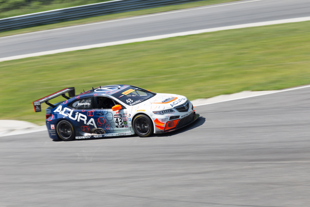 Ryan Eversley navigates his Acura TLX-GT through the uphill chicane in the GT practice session. There were three practice sessions in the morning, each 30 minutes in length, and three races in the afternoon, each 50 minutes in length. (Jackson Haigis/Daily Campus)