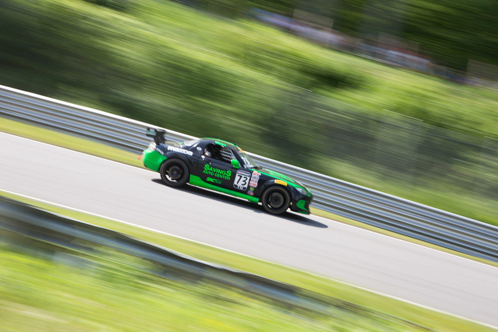 Daniel Moen's Mazda MX-5 Cup rockets down the downhill section of the track. The event ran from 9 am to 6 pm, providing fans with hours of live racing and an authentic racing environment. (Jackson Haigis/Daily Campus)