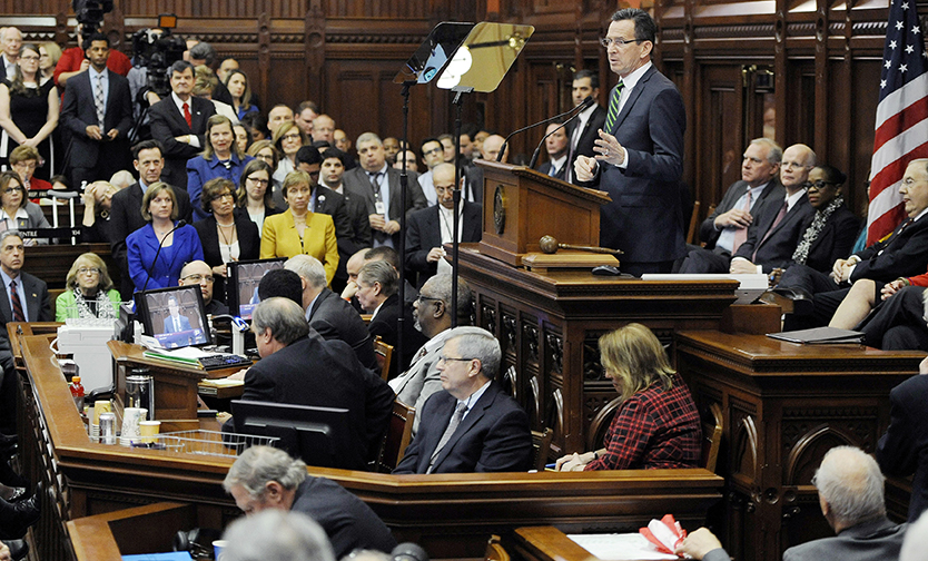 In this Feb. 3, 2016 file photo, Connecticut Gov. Dannel P. Malloy delivers an address to the senate and house inside the Hall of the House at the State Capitol in Hartford, Conn. (AP Photo/Jessica Hill, File)