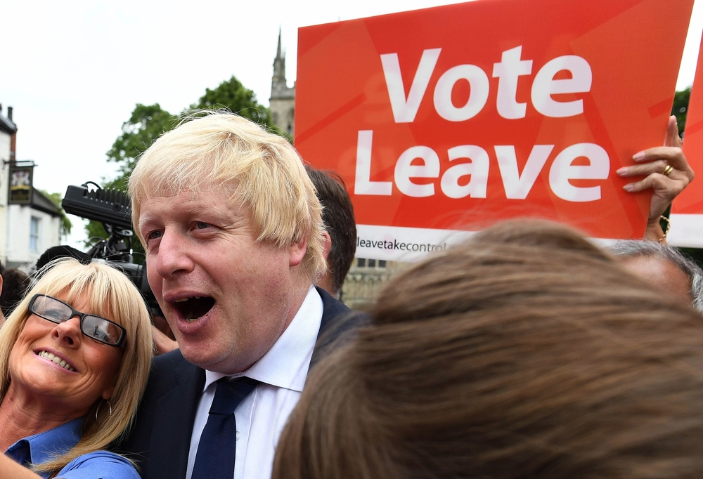 In this Wednesday, June 22, 2016 file photo, advocate to exit Europe Boris Johnson poses for a selfie photo with voters during a whistle stop tour of the country on the final day of campaigning before Thursday's EU referendum vote, in Selby, north England. (Andrew Parsons / PA via AP, File)