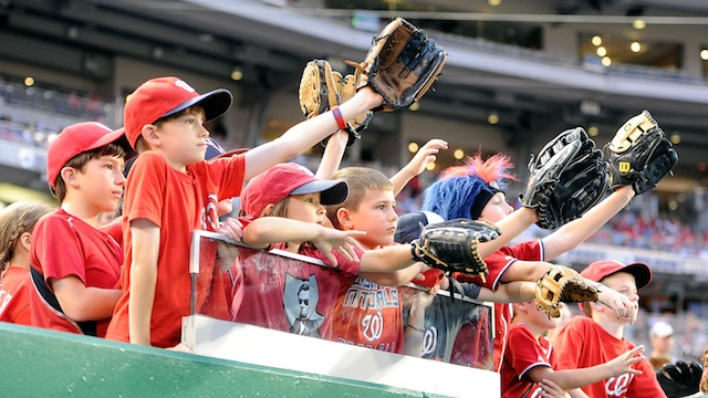 A pack of young fans eagerly attempt to garner the attention of their favorite team, the Washington Nationals. The MLB is facing a crisis with its youngest generation of fans: they are statistically watching less games than their parents or grandparents. (Photo courtesy of rantsports.com)