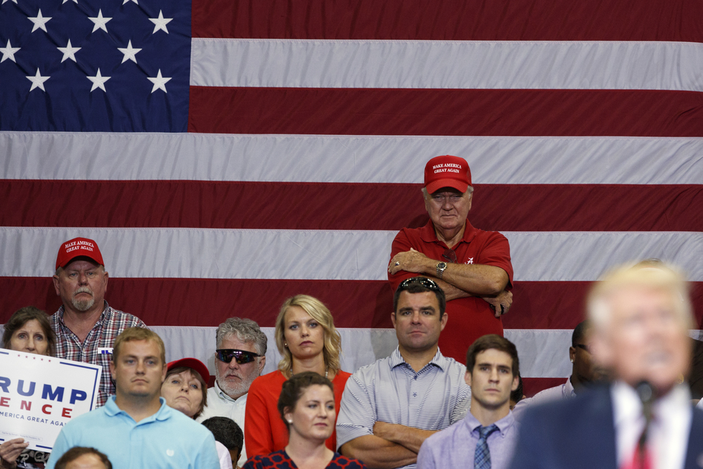 Supporters of Republican presidential candidate Donald Trump watch as he speaks during a campaign rally at Jacksonville Veterans Memorial Arena, Wednesday, Aug. 3, 2016, in Jacksonville, Fla. (AP Photo/Evan Vucci)