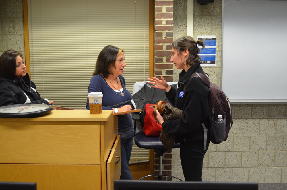 In this file photo, a student has a conversation in Homer Babbidge Library. Students pick their majors early on, but often change as they move through their years at UConn. (File photo/Daily Campus)