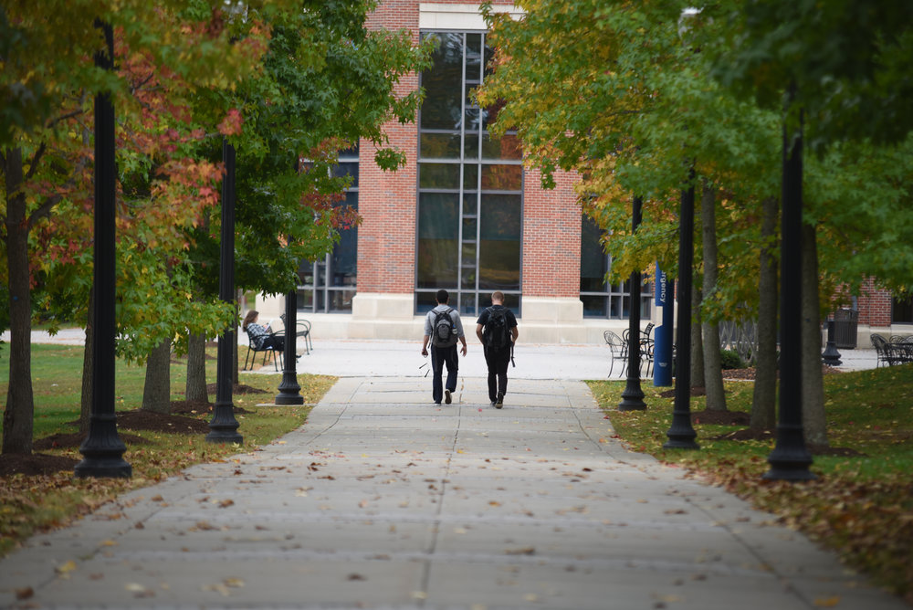 Students walk to class on South campus on a fall day. (Zhelun Lang/The Daily Campus)