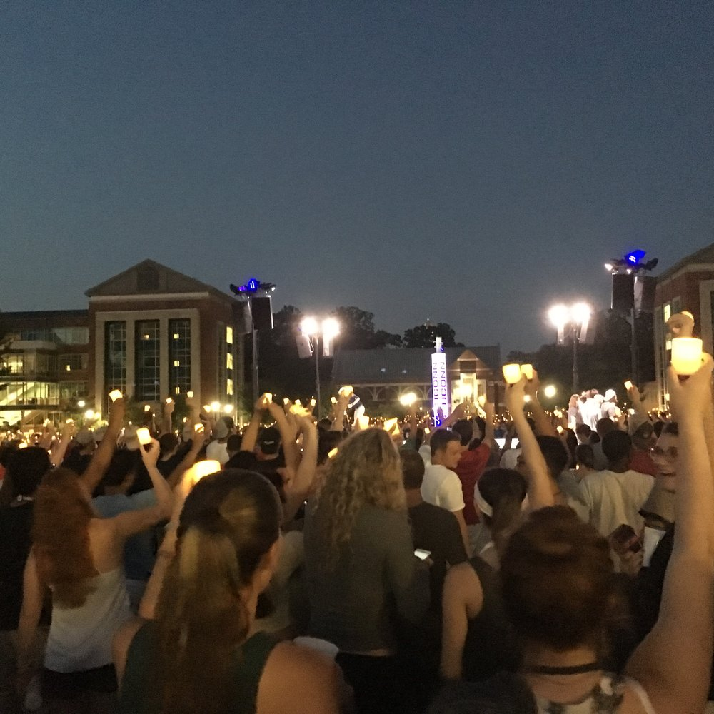 Thousands of students congregated on the Student Union Mall with artificial candles and phone screens in the air during Convocation on Friday, Aug. 26, 2016. (Christopher McDermott/The Daily Campus)