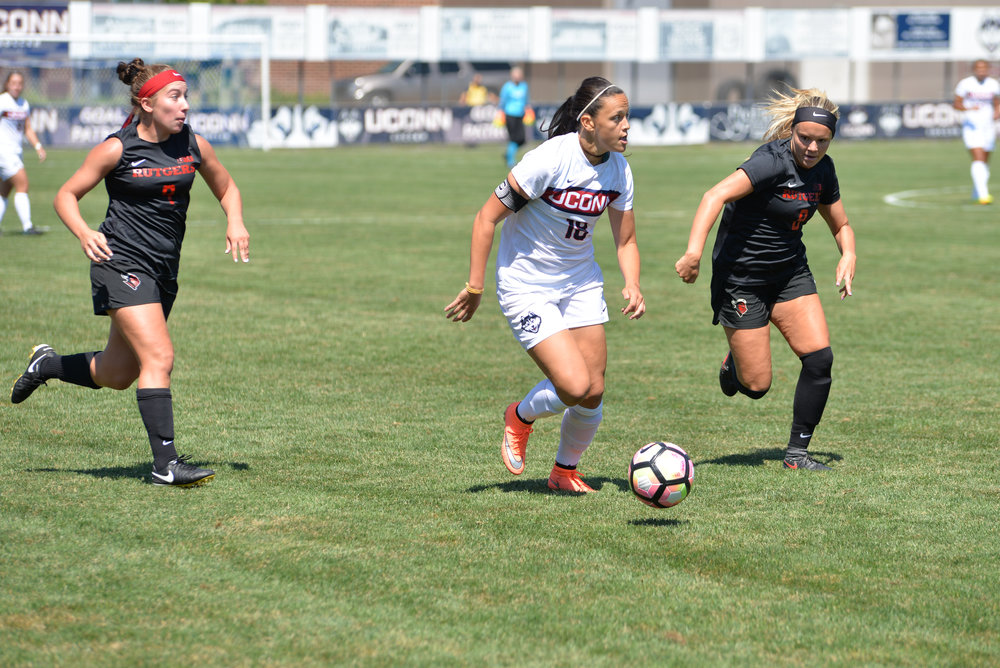 Senior forward Stephanie Ribeiro (#18) looks to make a play during No. 10 UConn's 2-0 loss to Rutgers at Morrone Stadium on Aug. 28, 2016. (Tyler Benton/The Daily Campus)