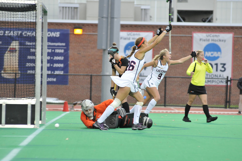 Charlotte Veitner (26) and Amelia Iacobucci (9) celebrate a goal during UConn's 4-1 victory over Princeton on Sunday, Oct. 25, 2015. The Huskies improved to 17-0 on the season with the victory. Veitner set the UConn single season record for points with 99 as a sophomore. (Jason Jiang/The Daily Campus)