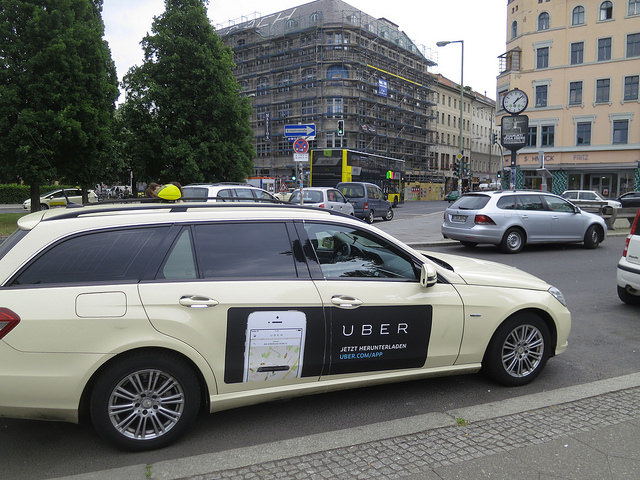 An Uber ad on the side of a car in Berlin. A student was hit by an Uber driver on Friday, Aug. 26, 2016. (Flickr/Alper Çuğun)